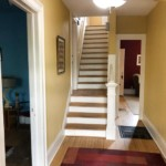 Stairs going up on the left, hallway on the right