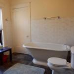 Clean bathroom with bathtub and window