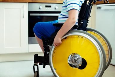 person in wheelchair in kitchen